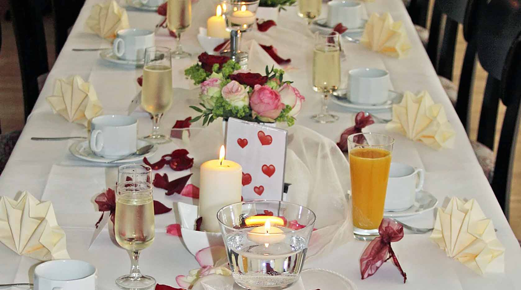 Wedding table setting with candles.